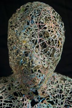 Head sculpture made from intricately cut street maps