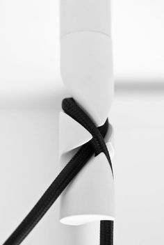 Product design: great fastening detail! Black and white joint close-up