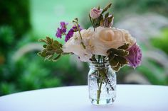 Cocktail Table Arrangement for summer time wedding with purple lisianthus and white tea roses. Purple Hydrangea Wedding, Wedding Flowers, Table Arrangements, Tea Roses, Cocktail Tables, Summer Time, Glass Vase, Floral, Inspiration
