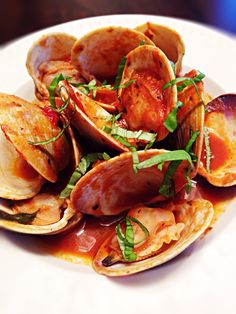 Quahog clams cooked in tomato vodka sauce with fresh basil