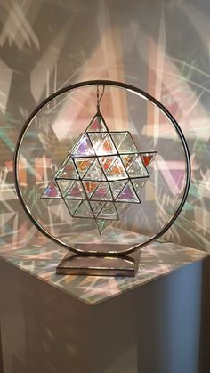 The 64 tetrahedron - 144 triangles of glass. Presented as a lamp, in a full moon custom made stainless steel stand. Contact us for inquiries. Geometric Pendant Light, Glass Pendant Light, Glass Pendants, Geometric Lamp, Geometric Sculpture, Light Art, Lamp Light, Geometric Artists, Making Glass
