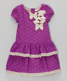 Airy butterflies and eyeleted fabric bring the best out of this frock's design. Ever-so sweet on little ladies, it has lace-trimmed tiers and playful puff-sleeves.100% cottonMachine wash; tumble dryImported