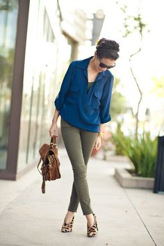 Olive pants make a great alternative to black pants or khakis, if your office has a more casual dress code. The silk blouse is sharp and the fierce animal print booties show you mean business.
