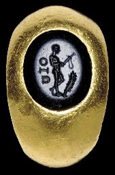 A ROMAN GOLD AND NICOLO FINGER RING                                                                                                                                                                       CIRCA 2ND CENTURY A.D.