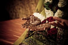 Coming Up Roses: Last Summer, this Pakistani-American bride wore traditional dress and complementary henna.  Source  achingly beautiful