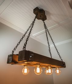 """The Double Barrel"" beam chandelier is a welcome new addition to our growing family of beam chandeliers. Made from cedar beams that are 3 feet long, it includes hand bent metal straps and heavy Rustic Light Fixtures, Rustic Lighting, Light Fittings, Wooden Chandelier, Wooden Lamp, Diy Luminaire, Double Barrel, Wood Beams, Room Lights"