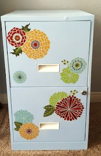 I don't think I can paint them, but I'm sure I could use decals- they have some that would be cute for the classroom in the kids bedding aisle at Target.  Filing Cabinet Makeover http://lovinglifeasmommy.blogspot.com/2012/02/filing-cabinet-makeover.html