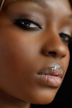 Matte makeup paired with high shine lip gloss is such a lovely look.