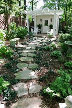 Shade garden- flagstone path to shed