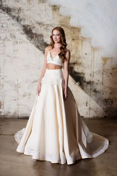 The crop top trend is here to stay and Tara LaTour has perfected it. The delicate lace triangle top is expertly paired with a blush, ivory dropped waist ball gown