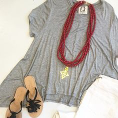 Summer was made for soft tees and this perfect Heather grey swing top is our new fave! $46. #tfssi stsimonsisland #sea island #summer2016 #newarrivals #summerstyle @peoplesprojectla