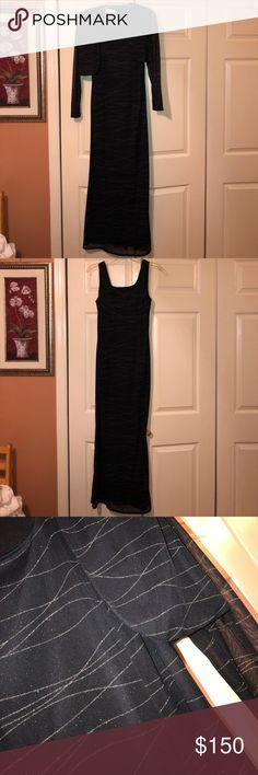 Evening Gown Sleeveless long black evening gown with silver detailing. Comes with matching cover up. Worn but in very good condition. Dresses Wedding
