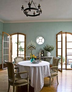 light blue walls with honey oak trim, I like the white crown molding mixed with the oak trim