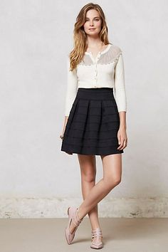 Flared ponte A-line skirt with tucked in cardigan or pretty sleeveless top, oxfords, flats, or opaque tights and ankle boots in cooler weather.