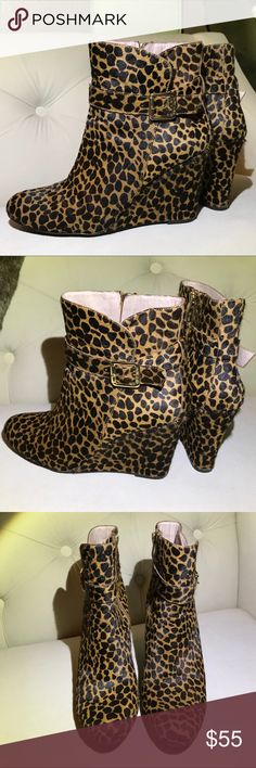 """Vince Camuto calf's fur leopard print boots Gorgeous  Vince Camuto wedge calf's fur leopard print boots. Gold hardware .  Gold Buckles on each side of ankles. Inner Zipper. Amazing with jeans. New No Tags.  3 1/4 """" height perfect Vince Camuto Shoes Wedges"""