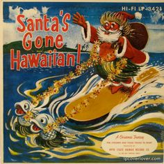 Check out the happy fish pulling Santa's surfboard.