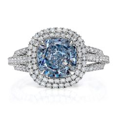 Blue diamond ring with double white diamond halo.