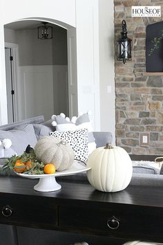 Love this simple display with a pumpkin, oranges and greenery  on a cake stand! (House of Silver Lining)
