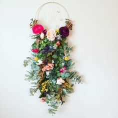 So in love with this enchanted garden piece!! This piece is the result of custom color changes being requested to my first floral extension dreamcatcher, and I loved the result! The base is a gold 10 hoop with a cream string, hand woven web, holding 9 specialty beads cascading down