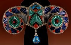 Boucheron corsage ornament – Lucien Hirtz ~ 1925 Most of the influential Jewellers at this time were producing Egyptian inspired pieces including Mellerio, Boucheron, Lalique, Baugrand, Lemonnier, Cartier and Giuliano, quite often using Cloisonne enamels.