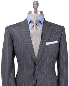 <ul> <li>Belvest Grey with Khaki Tonal Stripe Suit</li> <li>2 button jacket</li> <li>Grey melton</li> <li>Gold cupro lining</li> <li>Notch lapel</li> <li>Flap pockets</li> <li>Double vents</li> <li>Drop: 8</li> <li>Flat front pant</li> <li>100% wool</li> <li>Made in Italy</li> </ul>