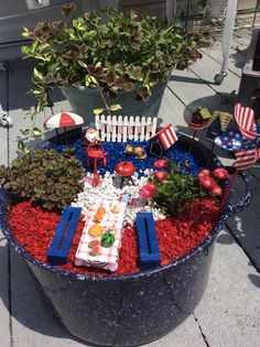 My patriot fairy garden turned out beautiful in old blue and white speckled pot.