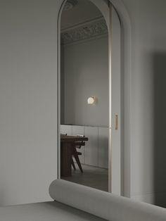Brass door detail in an interior designed by Emil Dervish and Evgeniy Bulatnikov