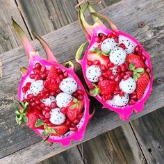 "Dragon fruit ""bowls"" filled with dragonfruit, strawberries, & pomegranate!"