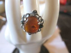 Vintage Baltic Amber With inclusions / Bits of Life, .925 Sterling Silver, Ring, Size 5. $30.00, via Etsy.