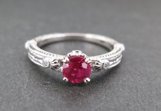 18k white gold deco ring with a ruby and diamonds.