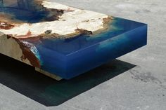 "Furniture designer Alexandre Chapelin (previously) wows us again with this new pair of tables that mimic a cross-section of an underwater reef. The Saint Martin-based artist uses natural stone encased in a translucent blue resin to ""bring the ocean into your living room."" You can see m"