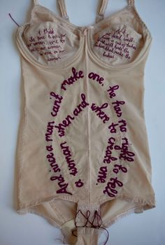 2pac's rap lyrics sewn into vintage lingerie as pop art. Hmm, din't realize 2pac made so much sense, though I thought he was commenting on how our bodies create life and then society says we're too fat and should wear a girdle. Props, 2pac!