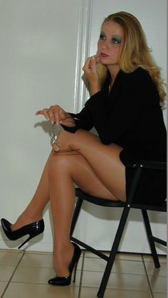 NICELY DRESSED GURLY HER MAKE UP IS LUSH AND HER LEGS IN THOSE TAN HOSE WITH THE HEELS HAS SOPHIE SERIOUSLY DROOLING, EVEN WITH THE CAGE ON :) XX