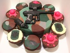 Cupcakes and paintball splattered cake! Who wants a slice? :) #guns #paintball #cake #ideas #war #party #birthday