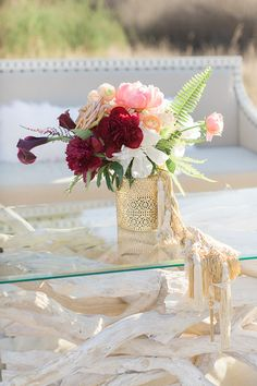 Modern Gold Centerpiece | Carlie Statsky Photography | Luxe Bohemian Wedding in Jewel Tones
