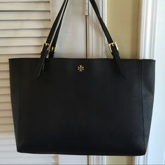 Tory Burch large York tote Good condition! There's some tears on the Straps, rubber peeled.. Not noticeable! Tory Burch Bags Totes