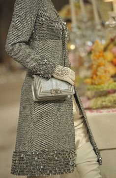 detail of tweed coat with bodice trim, profile