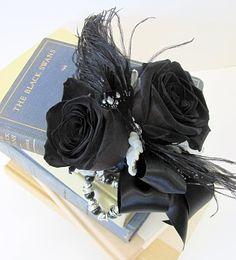 "Black swan wrist corsage - ""Twilight"" roses and black feathers."