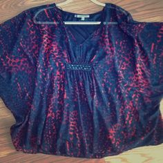 Black and red flowy blouse Really comfy and cute! Has a cute bead detail on the front near the waist. Could definitely fit a small Jennifer Lopez Tops Blouses