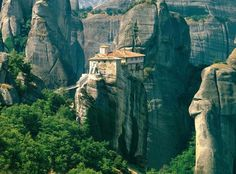 Meteora is a unique and spectacular landscape in central Greece. It is one of the most beautiful places in Greece. The area of Meteora on . Oh The Places You'll Go, Places To Travel, Places To Visit, Greece Wallpaper, Nature Landscape, Strange Places, Wonders Of The World, Beautiful Places, Amazing Places