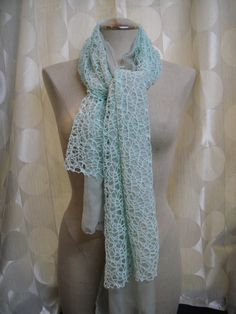 Beautiful mint color scarf.  Open weave on top of a sheer, lightweight material.