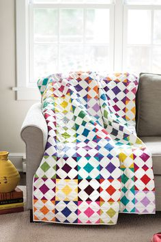 """Designer Thomas Knauer loves adding bits of color to the corners of squares, and then creating new shapes when the blocks are sewn together. This fat quarter friendly quilt features each color of your stash perfectly in 6"""" quilt blocks. Look for Diamond Dogs in Scrap Quilts Spring '15."""