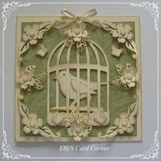 card: bird in a cage plue fanciful die cut flowers...olive and cream...