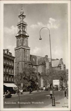 1950's. View on the Westerkerk in Amsterdam. The Westerkerk is a Protestant church at the Prinsengracht in Amsterdam. The church was built in 1620-1631 in the Dutch Renaissance style after a design by architect Hendrick de Keyser. The Westerkerk was one of the first purposely built Protestant churches. Other older churches like the Noorderkerk and Zuiderkerk were Roman Catholic churches that were converted to Protestant churches after the Reformation in 1578. #amsterdam #1950 #Westerkerk