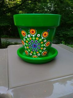 Painted clay flower pot with matching base Beautifully hand painted clay flower pot inspired mandala design. Flower Pot Art, Flower Pot Design, Clay Flower Pots, Flower Pot Crafts, Clay Pot Crafts, Clay Pots, Clay Flowers, Painted Plant Pots, Painted Flower Pots