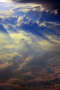 When I was little, I thought that the sun shining through the clouds was people going to Heaven..