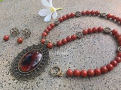 Red Jasper with antique spacers and a huge retro Oval pendant. Includes matching ear rings.