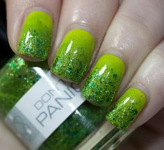 """Polish by 'Nerd Lacquer' part of the Hitchhiker's Guide Nail Collection. """"Don't Panic"""" is a brilliant clover green base with emerald and grass green glitter, plus a sprinkling of holographic sparkle. It's large, it's friendly, it's non-threatening, and it might even show you how to see the universe on less than thirty Altarian dollars a day. Don't forget your towel.  See them all at at Nerd Lacquer's site: http://www.nerdlacquer.com"""