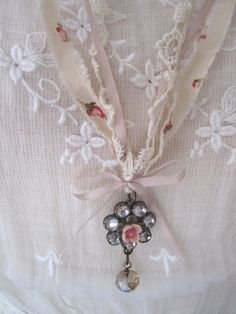Reserved for Patti Shabby Chic Necklace - love the torn edge rose-printed fabric it hangs from, and the little bow at the top of the pendant