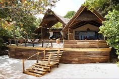 Fundu Lagoon Only accessible by boat or plane from... Zanzibar Hotels, Zanzibar Beaches, Robinson Crusoe, Bungalow, Luxury Beach Resorts, Tropical Architecture, Beautiful Places To Visit, Luxury Travel, Travel Around The World